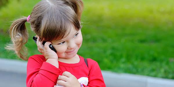 40821220 - little girl speaks by phone